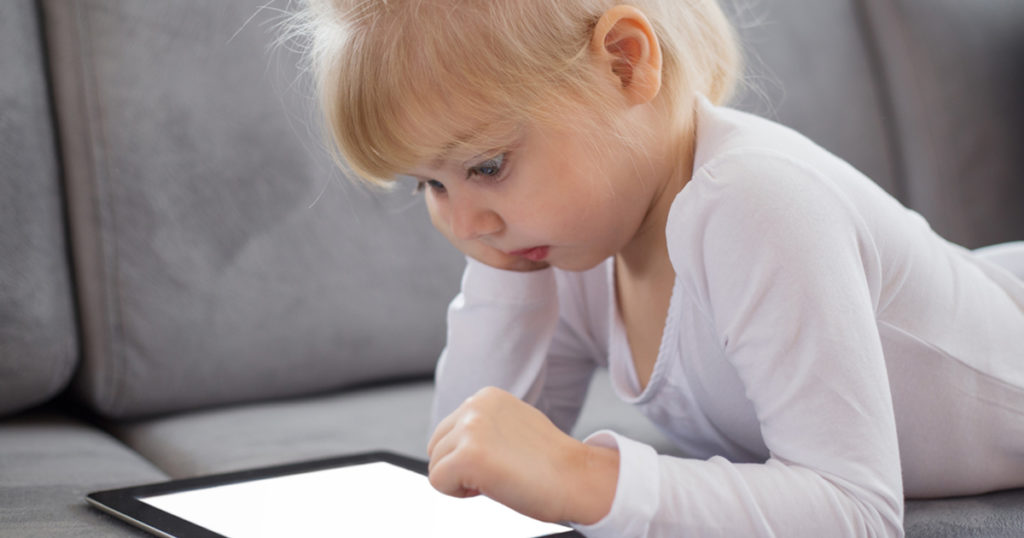 blonde-child-ipad-sofa-1200x630