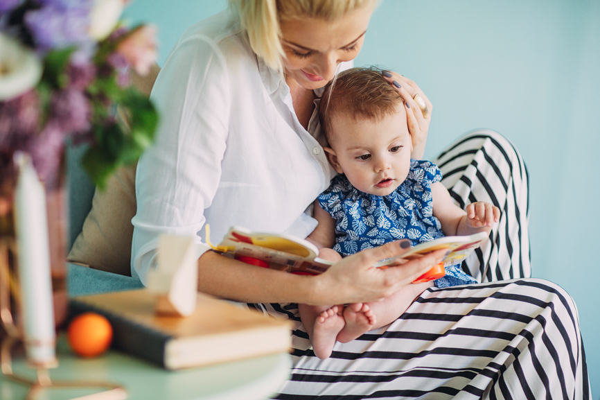 hooked-on-books-5-reasons-to-read-to-your-baby_mom-reading-to-intrigued-baby